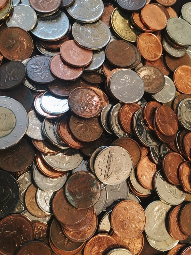 A zoomed in picture of hundreds of coins