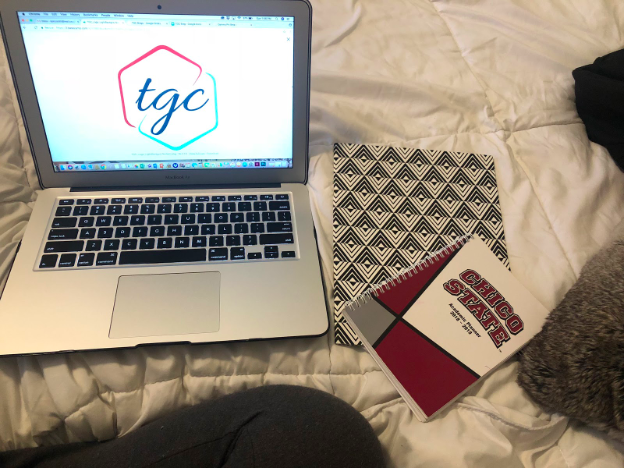 Picture of tgc laptop, planner and notebook.