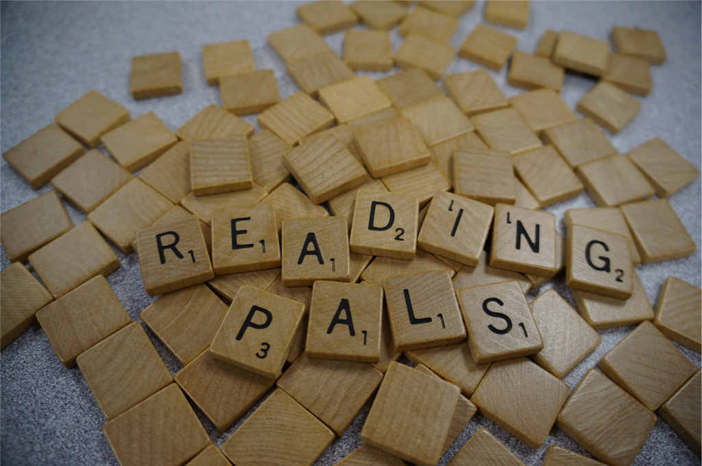 scrabble pieces spelling out Reading Pals